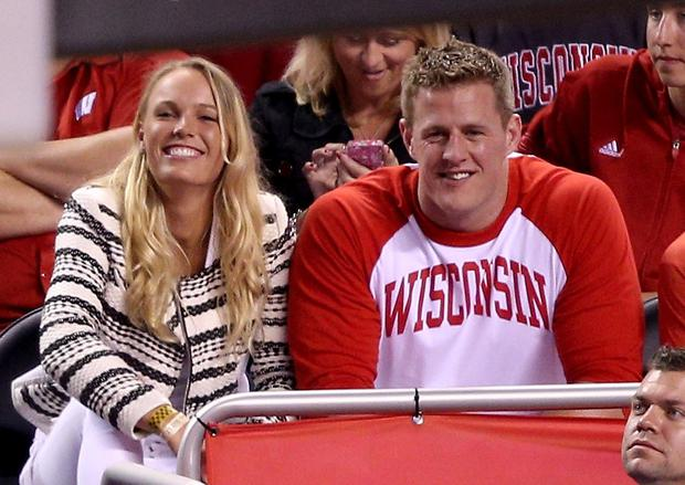 Tennis player Caroline Wozniacki and J.J. Watt of the Houston Texans look on from the crowd in the first half of the game between the Duke Blue Devils and the Wisconsin Badgers during the NCAA Men's Final Four National Championship at Lucas Oil Stadium on April 6, 2015 in Indianapolis, Indiana. (Photo by Joe Robbins/Getty Images)