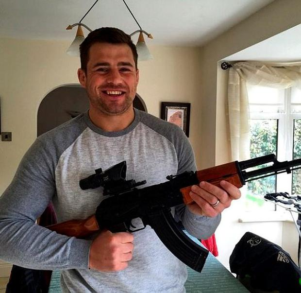 CJ Stander poses with his AK 47 Airsoft gun
