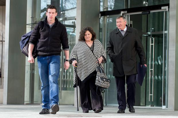 Graham Dwyer's brother James Dwyer (left), his father Sean (right), nother Susan (middle), at Dublin Central Criminal Court during the murder trial. Pic: Collins Courts.
