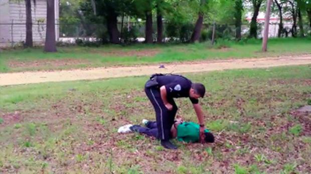 North Charleston police officer Michael Slager is seen standing over 50-year-old Walter Scott after allegedly shooting him in the back as he ran away, in this still image from video in North Charleston, South Carolina taken April 4, 2015. REUTERS/HANDOUT via Reuters