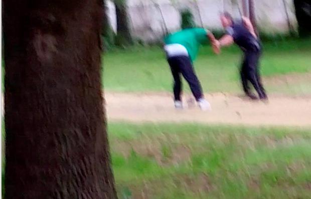 In this April 4, 2015, frame from video provided by Attorney L. Chris Stewart representing the family of Walter Lamer Scott, Scott appears to be struggling with City Patrolman Michael Thomas Slager, right, in North Charleston, S.C. (AP Photo/Courtesy of L. Chris Stewart)