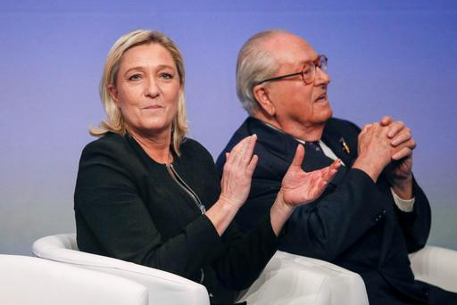 Marine Le Pen (L), France's National Front political party leader, sits next to her father Jean-Marie Le Pen during the French far-right party's congress in Lyon in this November 29, 2014 file photo. REUTERS/Robert Pratta/Files