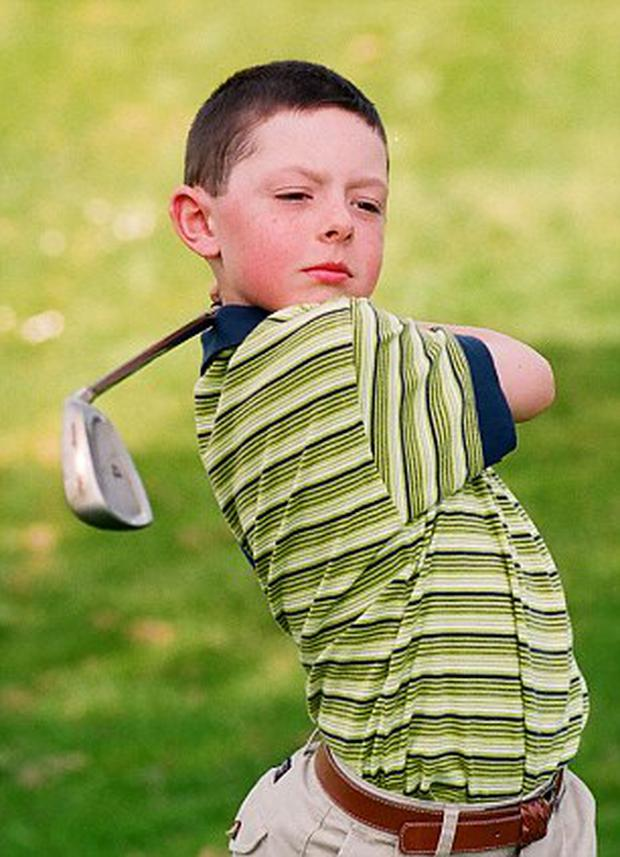 Alan Lewis - PhotopressBelfast.co.uk 9-4-2011 Rory McIlroy on his local golf course aged nine. He was practising for the first major tournament of his young career. He went on to win the Doral Junior Publix, World Under Ten Championship held in Florida, 1998.