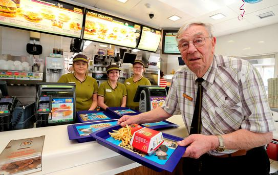 Bill Dudley, Europe's oldest McDonald's employee, celebrating his 90th birthday at the McDonald's, King Street, Mold, Flintshire, where he works two days a week. Peter Byrne/PA Wire