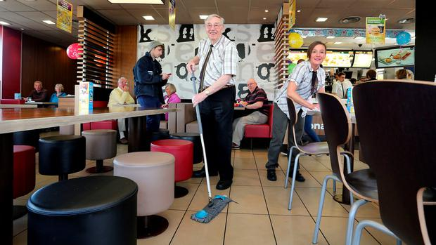 Bill Dudley, Europe's oldest McDonald's employee, celebrating his 90th birthday at the McDonald's, King Street, Mold, Flintshire, where he works two days a week. PRESS ASSOCIATION Photo. Picture date: Wednesday April 8, 2015. Great grandfather and Second World War veteran Mr Dudley, from Connah's Quay in North Wales, joined the fast food giant's Mold as a part-time member of the customer care team nine years ago after he grew