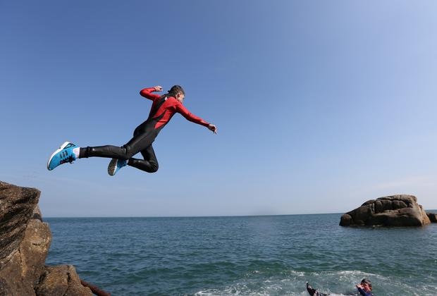Ciaran Burnett, from Dublin, jumps into the water at the Forty Foot in Sandycove, Dublin. Picture credit: Damien Eagers 7/4/2015