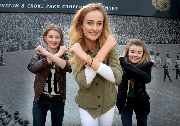 Triplets Katherine Maguire,(centre) from Wexford who auditioned for X Factor at Croke Park yesterday, pictured with her sisters Ellen (left) and Ciara .Pic Tom Burke 8/4/2015