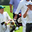 Rory McIlroy and his caddie, One Direction singer Niall Horan , walk the fairway during the Par 3 competition at Augusta National Golf Club in Augusta, Georgia. AFP PHOTO/DON EMMERTDON EMMERT/AFP/Getty Images