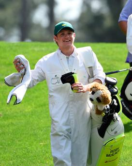 One Direction singer Niall Horan takes part in the Par 3 competition on April 8, 2015, at Augusta National Golf Club in Augusta, Georgia.Horan was the caddie for Rory McIlroy of Northern Ireland. AFP PHOTO/DON EMMERTDON EMMERT/AFP/Getty Images