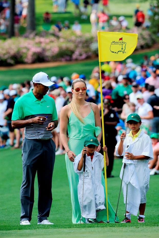 Tiger Woods of the United States, his girlfriend Lindsey Vonn, son Charlie and daughter Sam look on during the Par 3 Contest prior to the start of the 2015 Masters Tournament at Augusta National Golf Club on April 8, 2015 in Augusta, Georgia. (Photo by David Cannon/Getty Images)