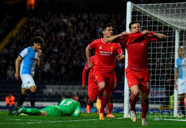 Philippe Coutinho celebrates scoring in the FA Cup quarter-final replay football match between Blackburn Rovers and Liverpool at Ewood Park.