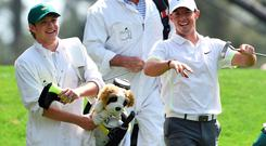 Rory McIlroy appears to be showing Niall Horan some dance moves as the One Direction singer caddied for him at the Par-Three tournament at the US Masters in Augusta
