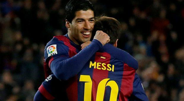 Barcelona's Lionel Messi and Luis Suarez (L) celebrate a goal against Almeria