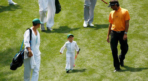 Bubba Watson of the U.S. participates in the par 3 event with his wife Angie (L) and son Caleb ahead of the 2015 Masters at Augusta National Golf Course in Augusta