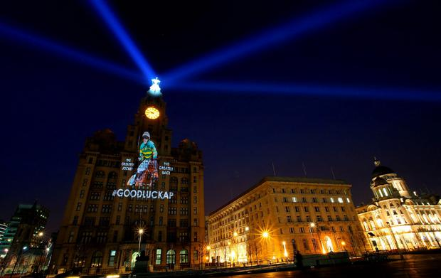 A projection of AP McCoy is seen on the Liver Building in Liverpool ahead of the Crabbies Grand National Festival which starts tomorrow at Aintree Racecourse. PRESS ASSOCIATION Photo. Picture date: Wednesday April 8, 2015. Photo credit should read: Peter Byrne/PA Wire