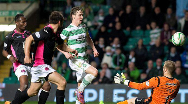Partick Thistle goalkeeper Scott Fox (right) saves from Celtic's Stefan Johansen (second right) during the Scottish Premiership match at Celtic Park, Glasgow