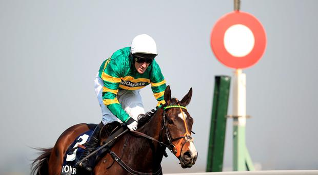 Jezki ridden by Jockey Tony McCoy wins the Doom Bar Aintree Hurdle during the Grand Opening Day of the Crabbies Grand National Festival at Aintree