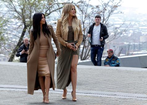 Kim Kardashian, left and sister Khloe Kardashian walk in Victory Park while filming in Yerevan, Armenia. (AP photo/Artur Harutyunyan, PAN Photo)