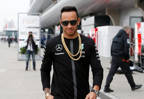 Mercedes driver Lewis Hamilton of Britain walks at the paddock of Shanghai International Circuit in Shanghai, China