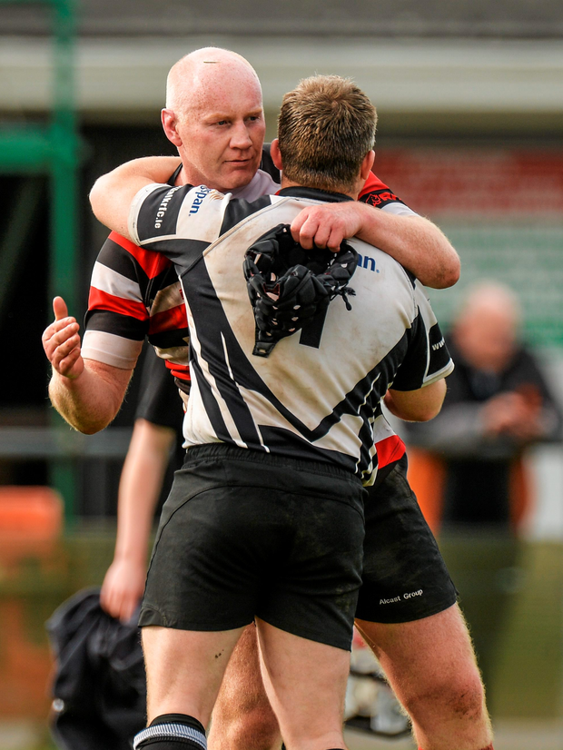 Declan O'Brien, Enniscorthy, consoles Johnny Gray, Dundalk, after the game (SPORTSFILE)