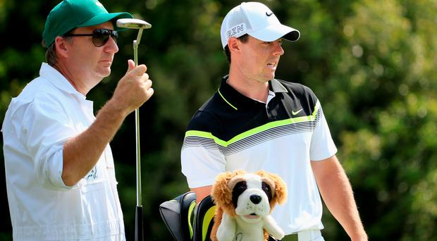 AUGUSTA, GA - APRIL 09: Rory McIlroy of Northern Ireland and his caddie J.P. Fitzgerald during the first round of the 2015 Masters Tournament at Augusta National Golf Club on April 9, 2015 in Augusta, Georgia. (Photo by Jamie Squire/Getty Images)