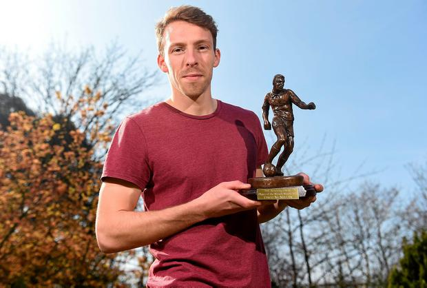 David McMillan with the SSE Airtricity League Player of the Month award for March.