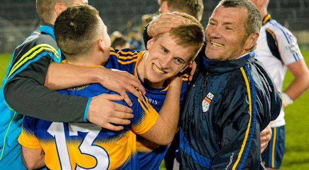 9 April 2015; Paul Maher, Tipperary, celebrates with teammates and coaches after the victory. EirGrid Munster U21 Football Championship Final, Tipperary v Cork, Semple Stadium, Thurles, Co. Tipperary. Picture credit: Cody Glenn / SPORTSFILE