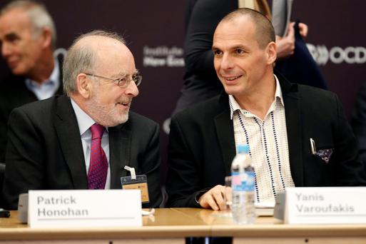 Central Bank Governor Patrick Honohan (left) and Greek Finance Minister Yanis Varoufakis at the annual conference of the Institute for New Economic Thinking in Paris