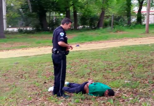 Officer Michael Slager stands over Walter Scott. Photo: AP