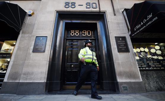 A police officer exits the Hatton Garden Safe Deposit company in the City of London. Photo: EPA