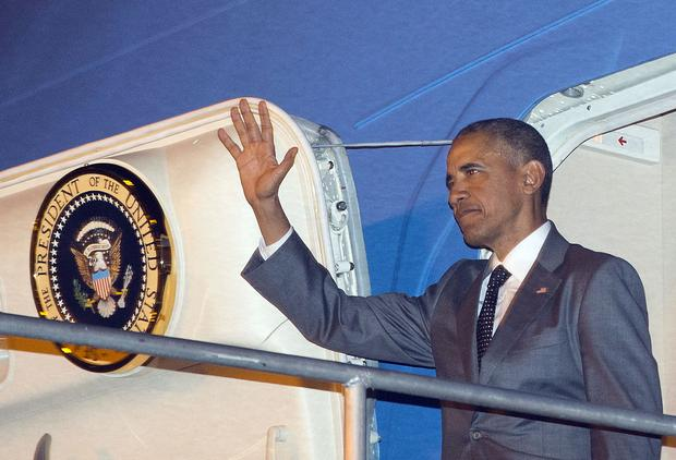 U.S. President Barack Obama waves during his arrival on Air Force One Thursday, April 9, 2015, at Tocumen International Airport in Panama City, Panama. (AP Photo/Pablo Martinez Monsivais)
