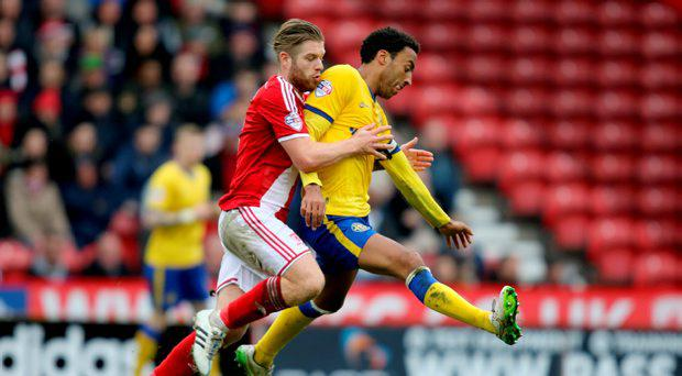 Middlesbrough's Adam Clayton challenges Wigan's James Perch