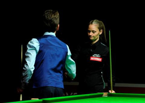 Ken Doherty shakes hands with Reanne Evans after his victory in their match at the World Championship Qualifying at Ponds Forge, Sheffield.
