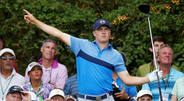 Jordan Spieth of the U.S. points to the direction his drive is heading off the 14th tee during first round play of the Masters golf tournament at the Augusta National Golf Course in Augusta, Georgia. REUTERS/Jim Young