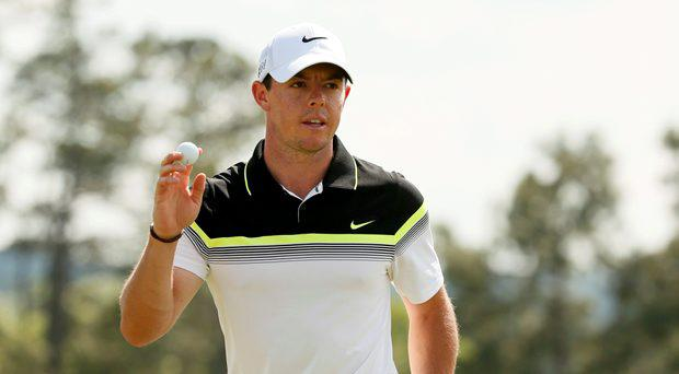 Rory McIlroy of Northern Ireland waves to the crowd as he finishes out the18th hole during first round play of the Masters golf tournament at the Augusta National Golf Course in Augusta, Georgia April 9, 2015