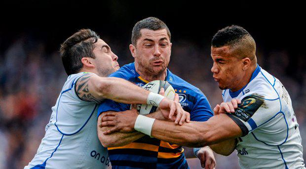 Rob Kearney, Leinster, is tackled by Horacio Agulla, left, and Anthony Watson, Bath