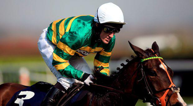 Jezki ridden by Jockey Tony McCoy wins the Doom Bar Aintree Hurdle during the Grand Opening Day of the Crabbies Grand National Festival at Aintree Racecourse, Liverpool