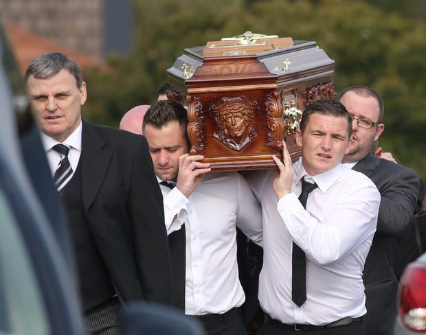 The coffin is carried to St Joseph's Church in Rathnew for the funeral of Anne Shortall