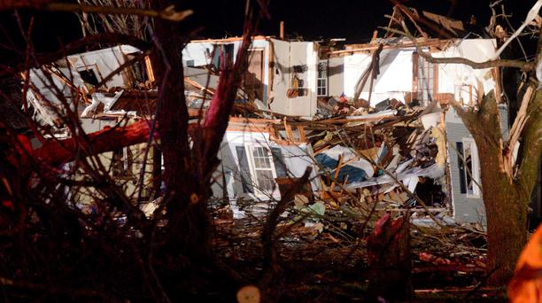 A tornado struck the small town of Fairdale Ill (AP Photo/Daily Herald, Patrick Kunzer )