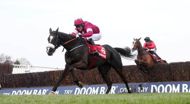 Don Cossack ridden by Tony McCoy on his way to winning the 15.25 Betfred Melling Chase