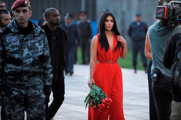 US reality TV star Kim Kardashian (C) and her rapper husband Kanye West (3rdL) visit the genocide memorial, which commemorates the 1915 mass killing of Armenians in the Ottoman Empire, in Yerevan on April 10, 2015. AFP PHOTO / KAREN MINASYANKAREN MINASYAN/AFP/Getty Images
