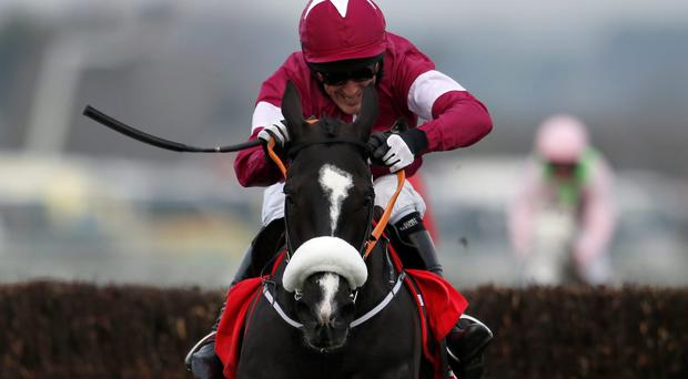 Tony McCoy riding Don Cossack clear from the last to win The Betfred Melling Chase at Aintree yesterday