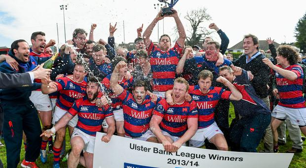 Clontarf players celebrate their Ulster Bank League Division 1A triumph last year