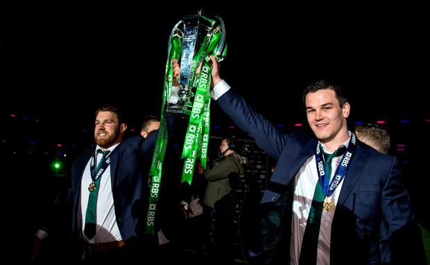 Ireland's Sean O'Brien (left) and Jonathan Sexton with the Six Nations trophy at Murrayfield, Scotland. Photo: Brendan Moran/ Sportsfile