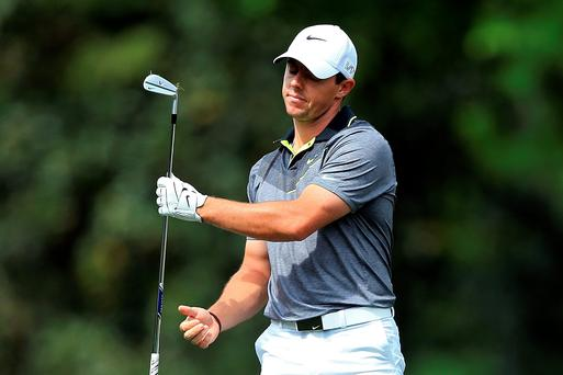 Rory McIlroy shows his frustration during a difficult first nine at Augusta yesterday that left him trailing Jordan Spieth. Photo: David Cannon/Getty Images