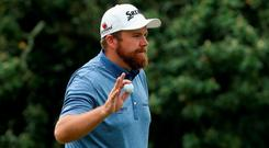 Shane Lowry got no more than he deserved on 17 when he holed a 27-foot birdie putt to bring himself back to even-par. Photo: Andrew Redington/Getty Images