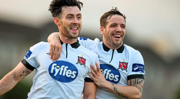 4 April 2015; Richie Towell, left, Dundalk, is congratulated by team-mate Darren Meenan after scoring his side's first goal. SSE Airtricity League Premier Division, Limerick FC v Dundalk. Jackman Park, Limerick. Picture credit: Diarmuid Greene / SPORTSFILE
