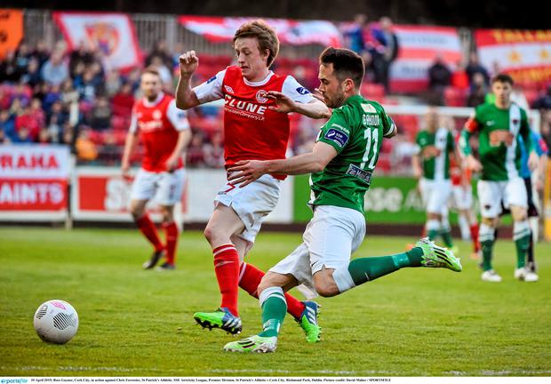 Ross Gaynor, Cork City, in action against Chris Forrester, St Patrick's Athletic.