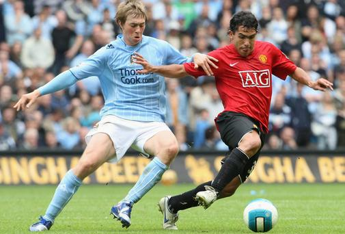 Michael Johnson in action against Carlos Tevez during the Manchester derby in August 2007. Photo: John Peters/Manchester United via Getty Images