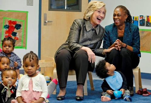 """Former US Secretary of State Hillary Clinton and New York first Lady Chirlane McCray share a laugh while they attend the early childhood development initiative """"Talk to Your Baby"""" in Brooklyn, New Yorkmia"""
